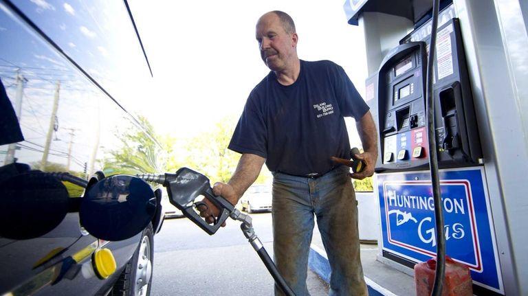 Kurt Hucke, of Huntington, pumps gas Wednesday at