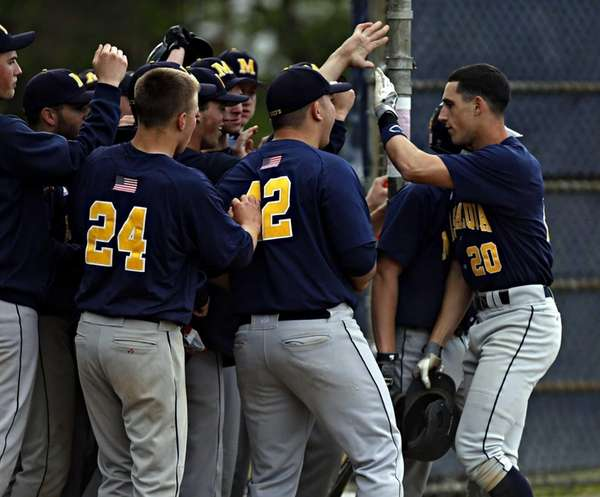 Massapequa's Eric Hassell is congratulated by teammates at