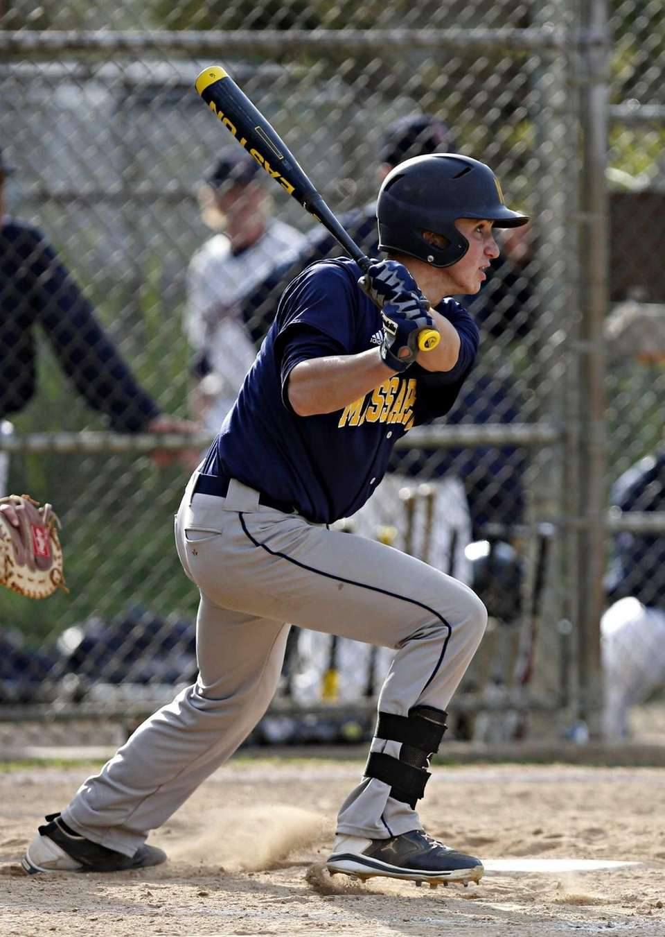 Massapequa's Bobby Honeyman hits a single to left