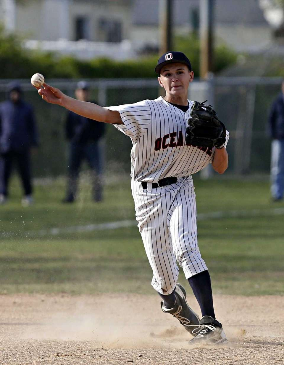 Oceanside shortstop Kyle Martin throws out Massapequa's Nick