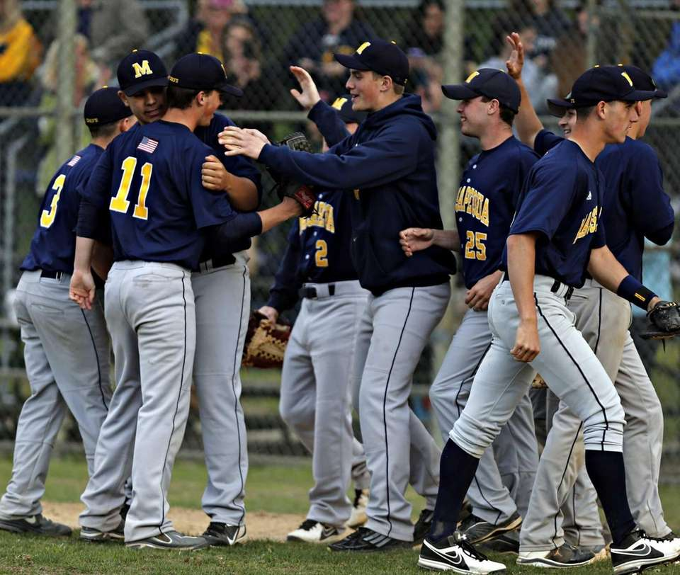 Massapequa's baseball team congratulate pitcher Patrick Healy after