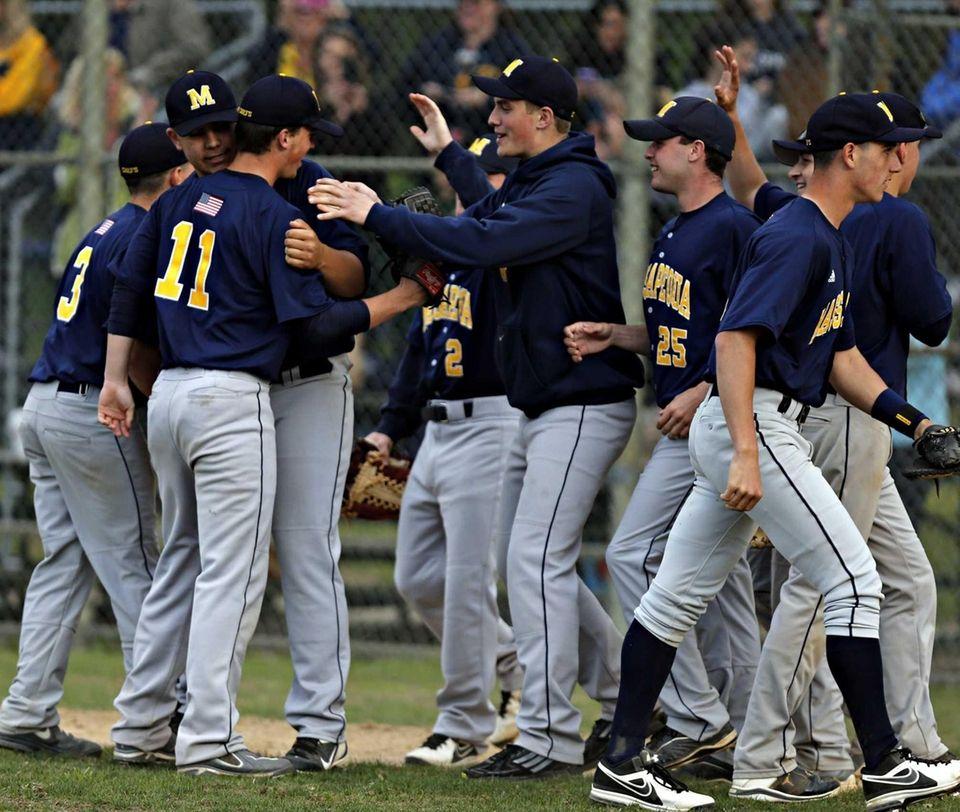 Massapequa's baseball team congratulate pitcher Patrick Healy after