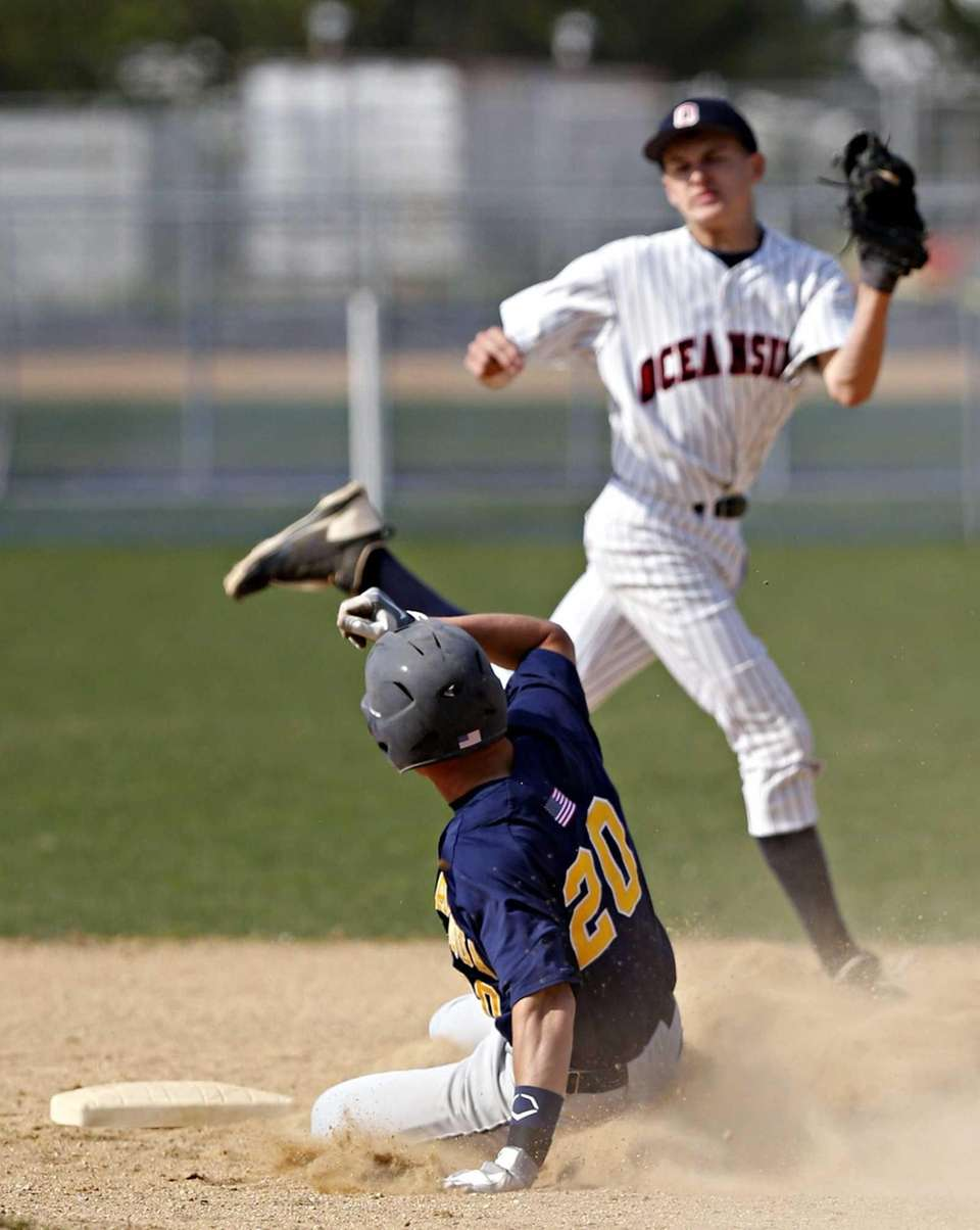 Massapequa's Eric Hassell steals second with two outs