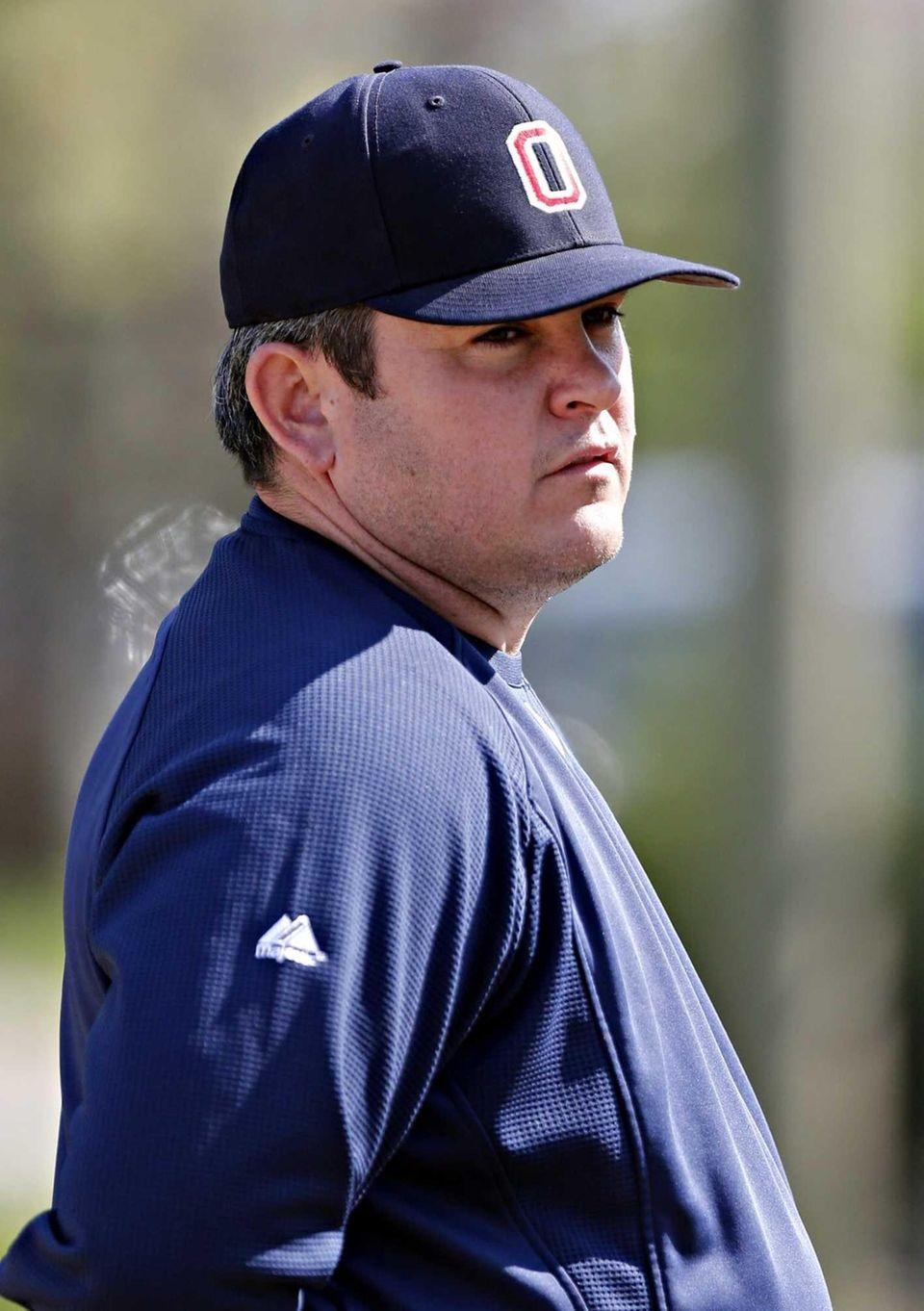 Oceanside varsity baseball head coach Mike Postilio watches