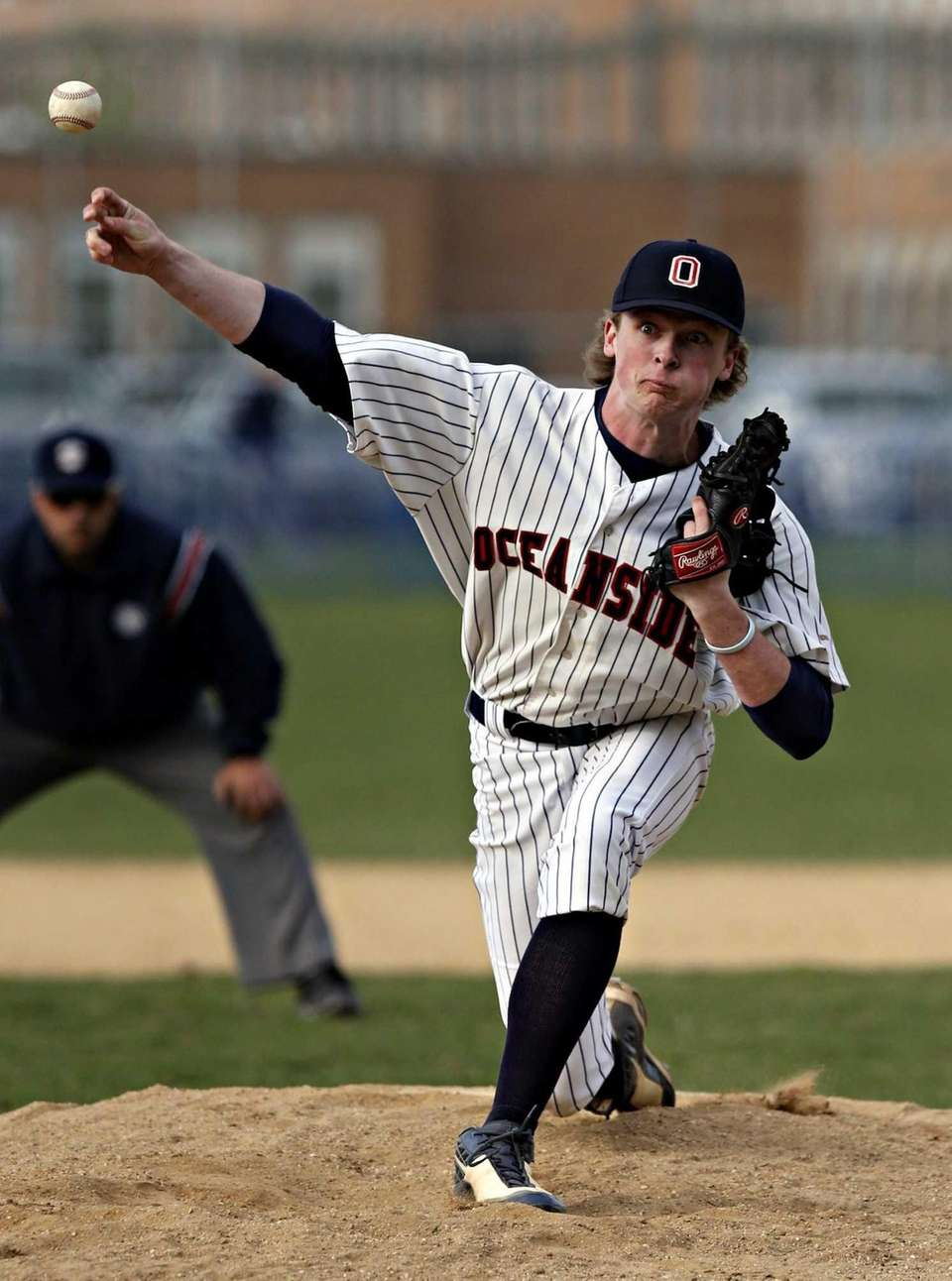 Oceanside's Pat Broder pitches in relief in the