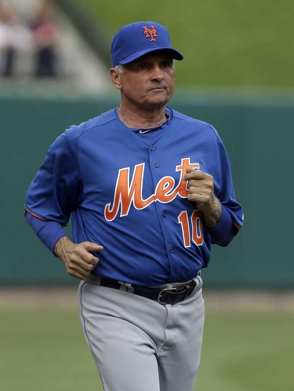Terry Collins watches batting practice before the start