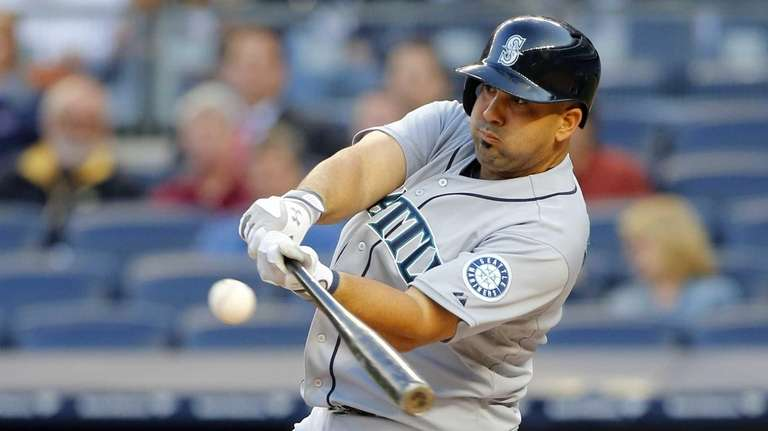 Kendrys Morales #8 of the Seattle Mariners connects