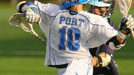 Port Washington's Joey Froccaro #10 fights off Plainview