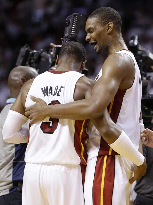 Miami Heat's Dwyane Wade (3) and Chris Bosh,