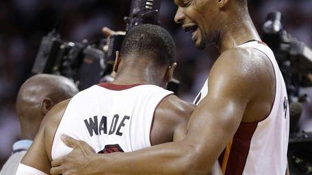 Miami Heat's Dwyane Wade (3) and Chris Bosh,