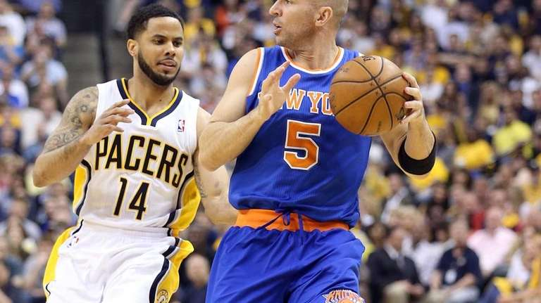 Jason Kidd dribbles the ball against the Indiana