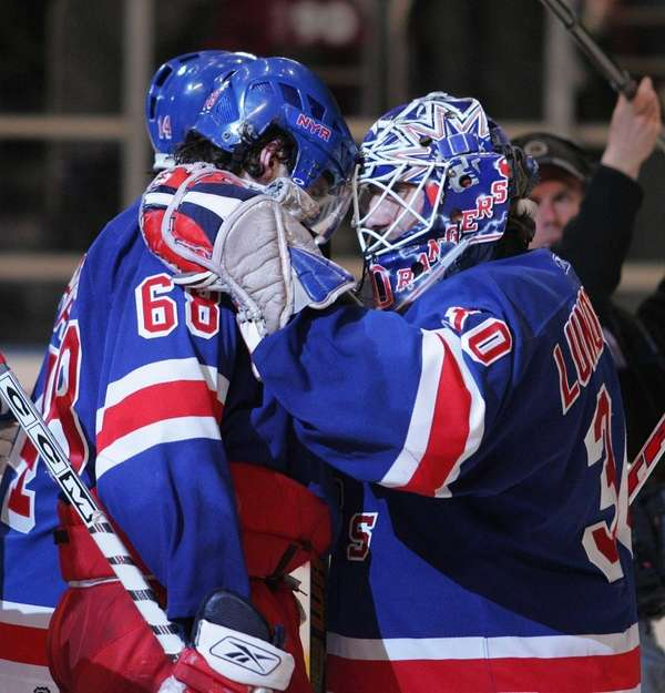 Then-Rangers captain Jaromir Jagr celebrates with Henrik Lundqvist