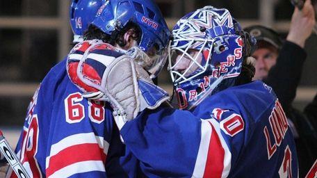 Then-Rangers captain Jaromir Jagr celebrates with Henrik Lundqvist