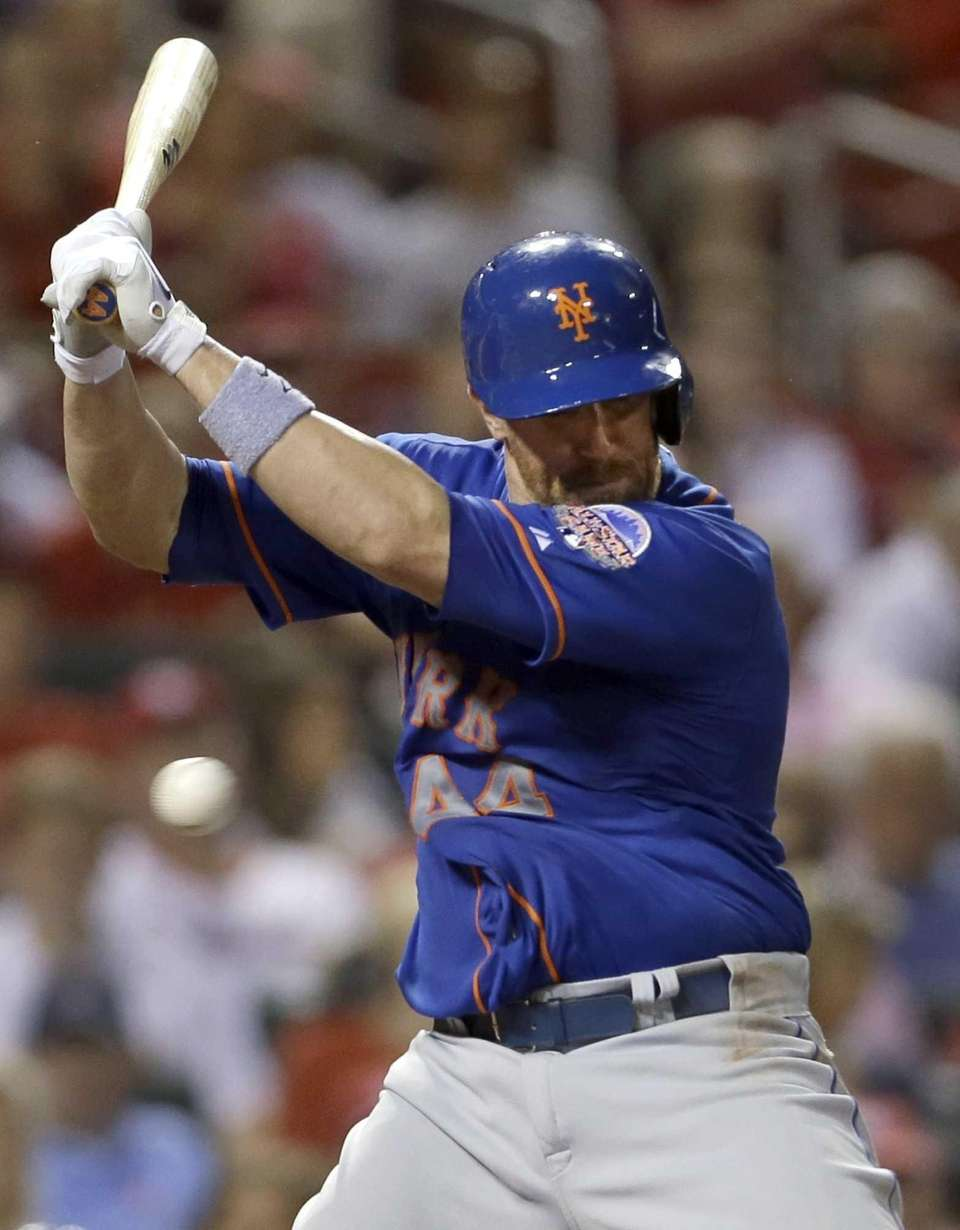 Mets' John Buck is hit by a pitch