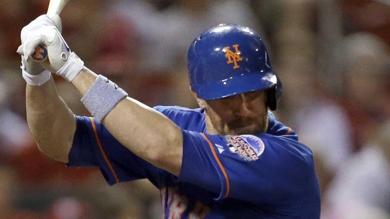 Mets' John Buck is hit by a pitch
