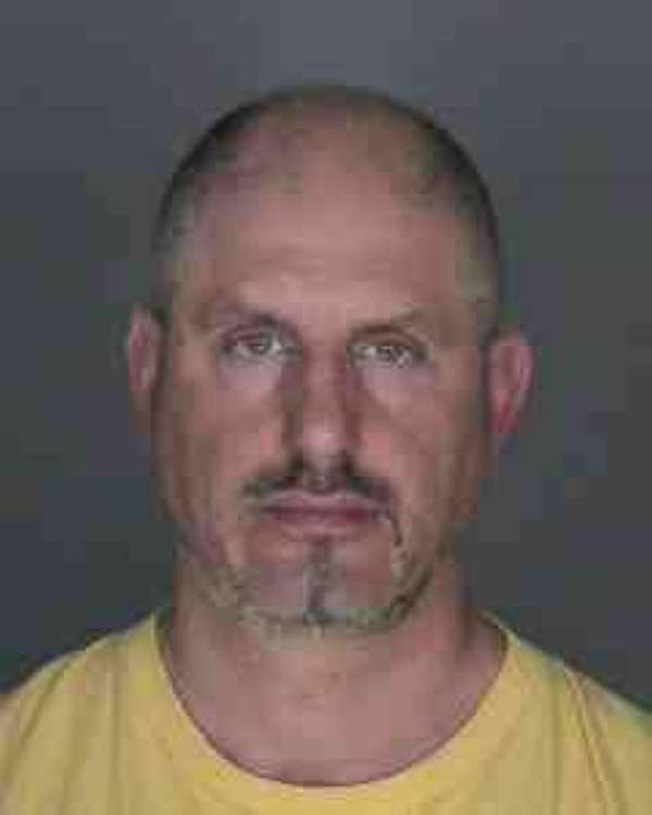 John Orlandini, 49, of Long Beach surrendered Wednesday