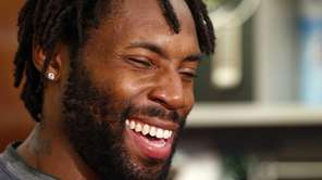 New York Jets cornerback Antonio Cromartie laughs as