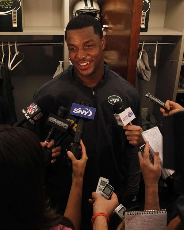 Quinton Coples speaks to the media at the