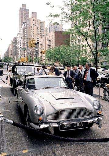 People gaze at a 1963 Aston Martin, which