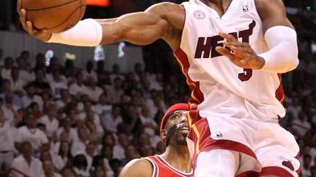 Miami Heat's Dwyane Wade gets inside for two