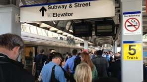 Commuters wait at Jamaica station in Queens for