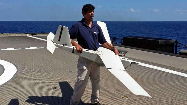 Stuart Orozco, flight operator with Aeronvironment Inc., prepares