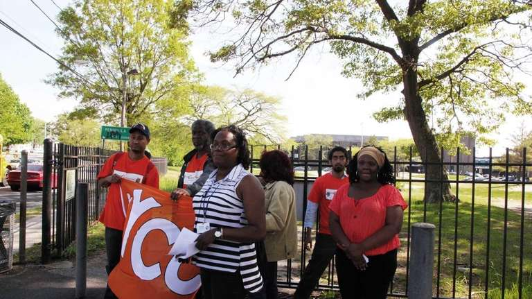 Parents, community leaders, and students rally outside Hempstead
