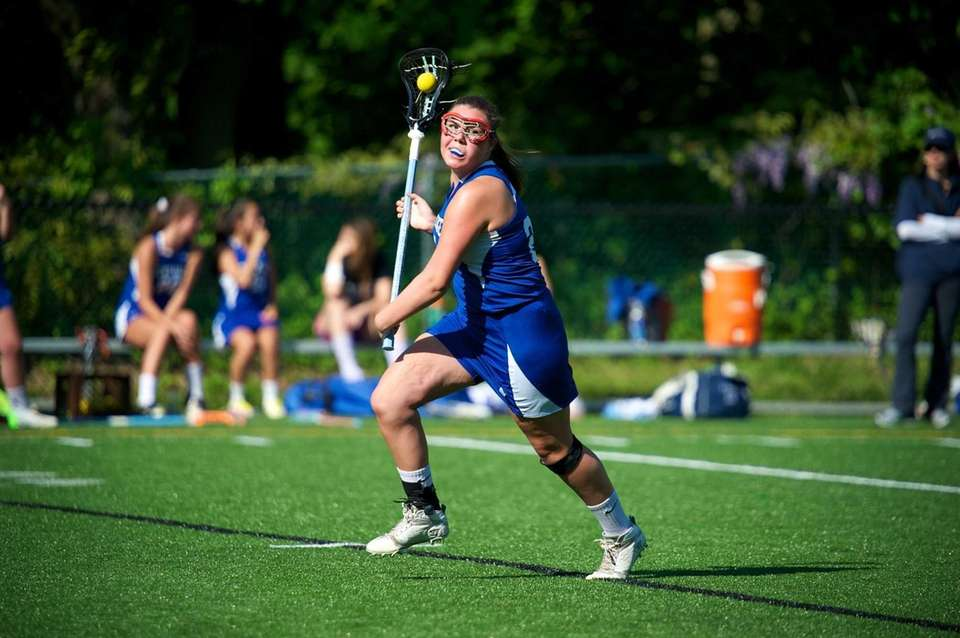 Portledge's Allaire Gahagan drives toward the net in