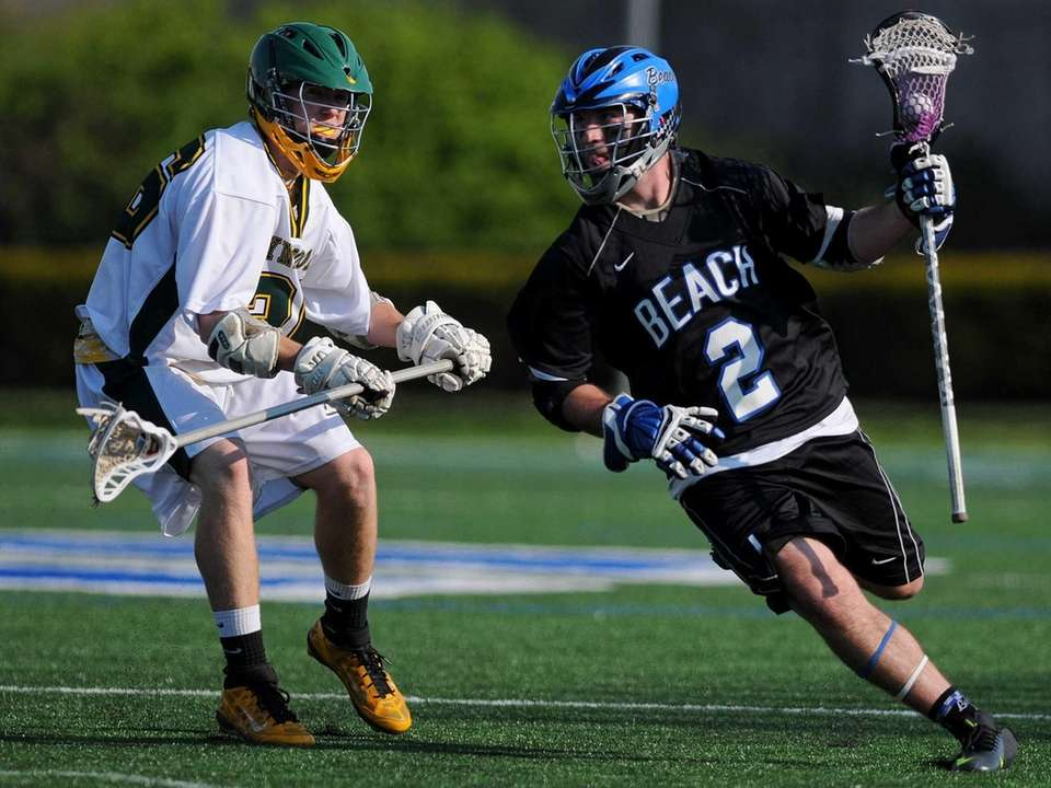 Long Beach's James Forkin, right, looks to get