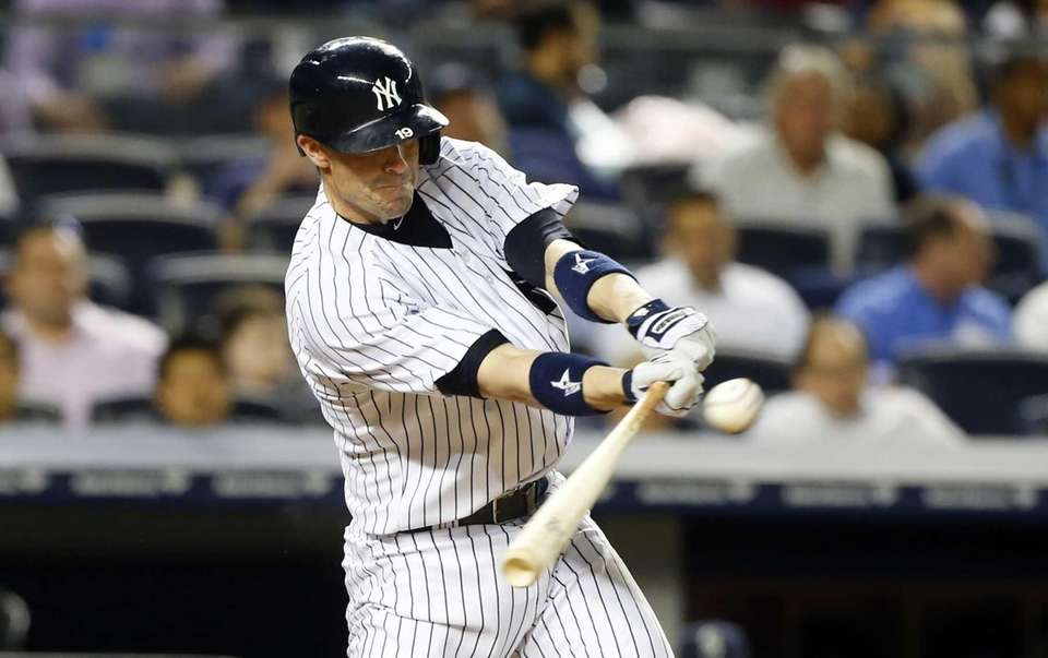 Chris Stewart of the Yankees connects on a