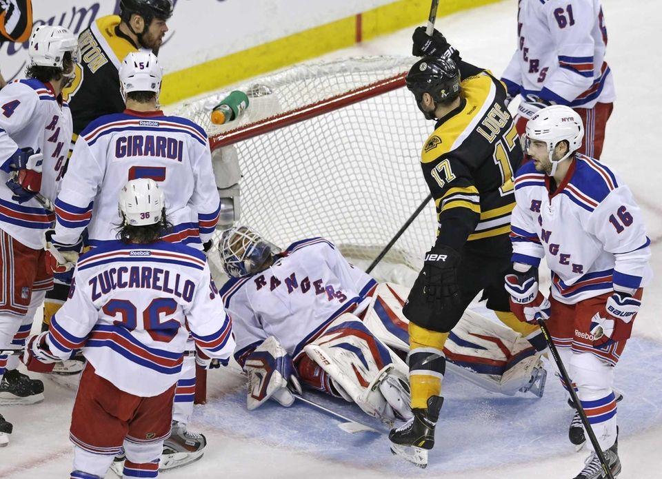 Boston Bruins left wing Milan Lucic raises his