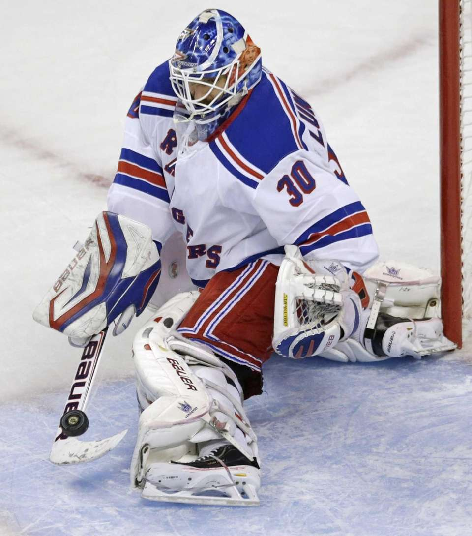Rangers goalie Henrik Lundqvist makes a stick-save against