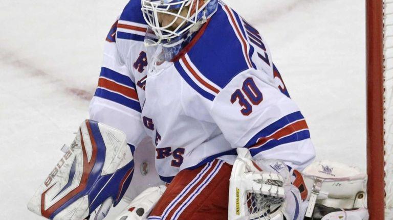 Rangers goalie Henrik Lundqvist makes a stick-save against