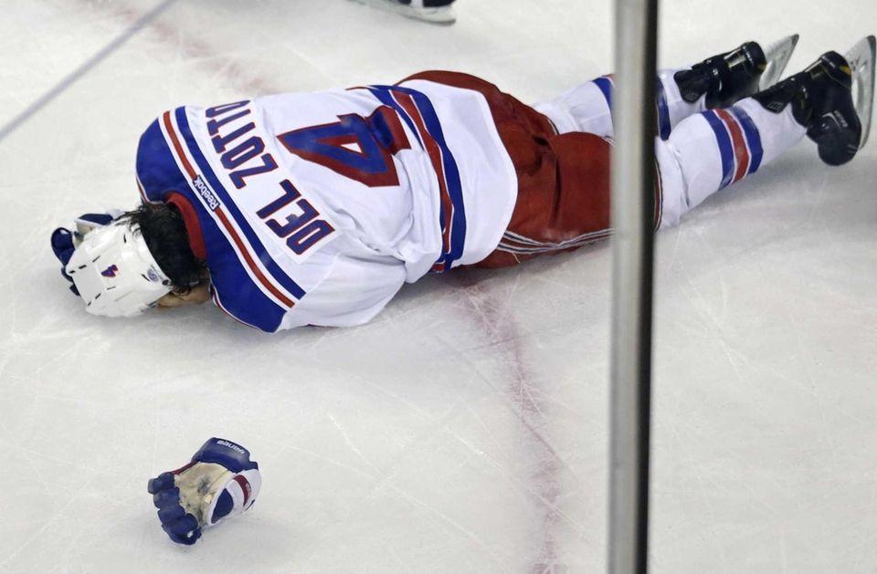 Rangers defenseman Michael Del Zotto grabs his head