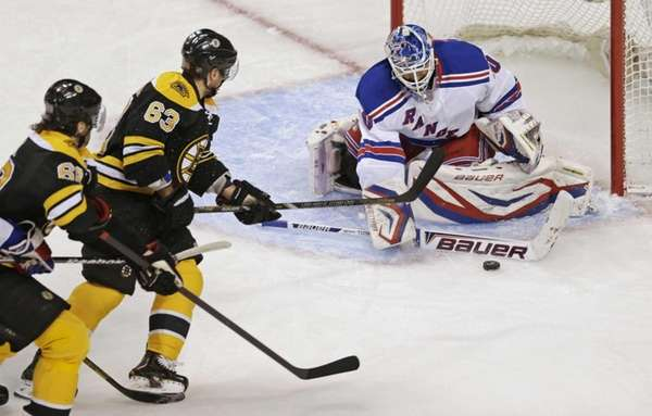 Rangers goalie Henrik Lundqvist, right,drops his stick to