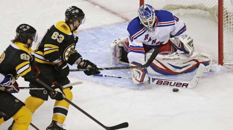 Rangers goalie Henrik Lundqvist, right,drops his stick to