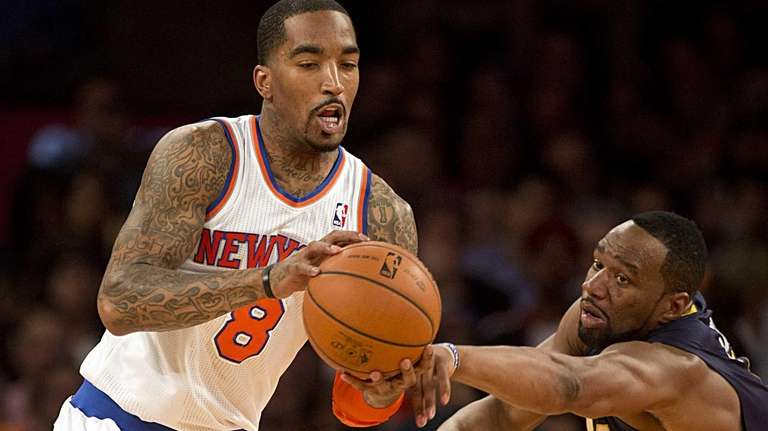 Knicks' JR Smith has the ball knocked from