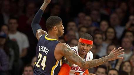 Knicks' Carmelo Anthony is guarded by the Indiana