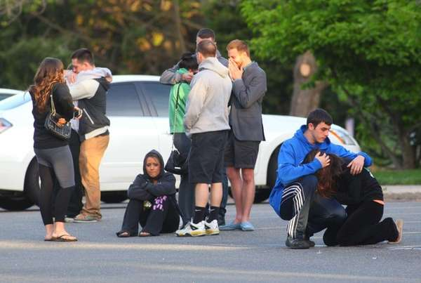 Friends and Hofstra students react after learning of a fatal shooting on California Avenue in Uniondale. (May 17, 2013)