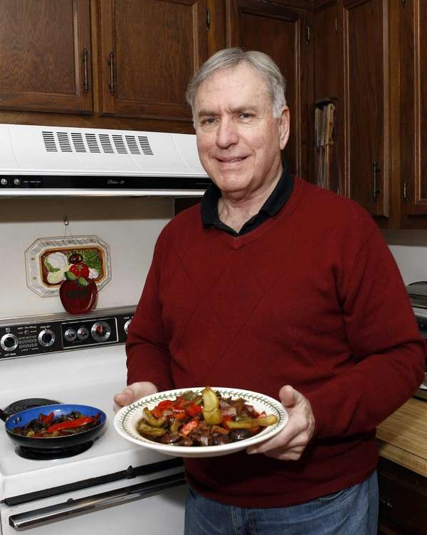 Peter Monaco with his chicken scarpariello dish, which