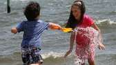 Danial Parveez, 4, plays in the water with