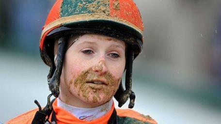 Rosie Napravnik looks on after a race prior