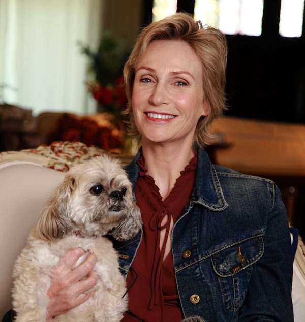 Jane Lynch with Olivia, an Lhasa Apso breed,