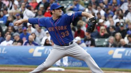 Mets starting pitcher Matt Harvey delivers during the