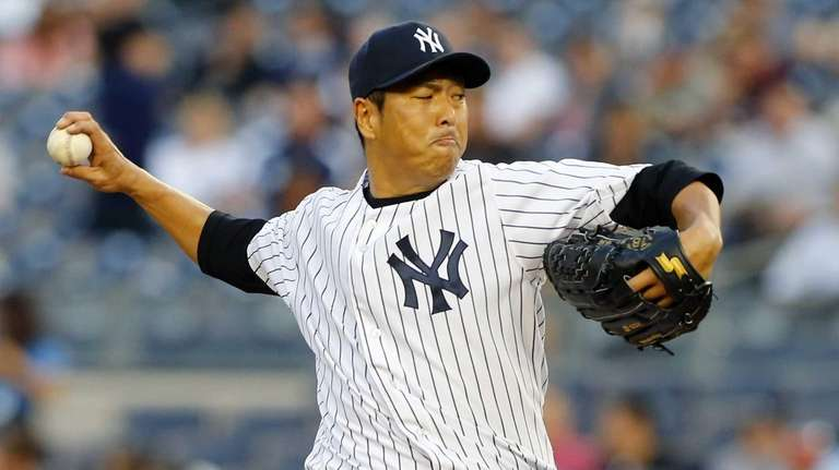 Hiroki Kuroda of the Yankees pitches in the