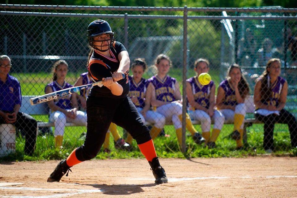 East Rockaway pitcher Gianna Cilluffo swings at a
