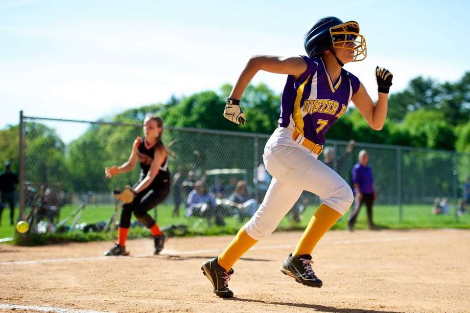 Oyster Bay center fielder Madison Albert runs to