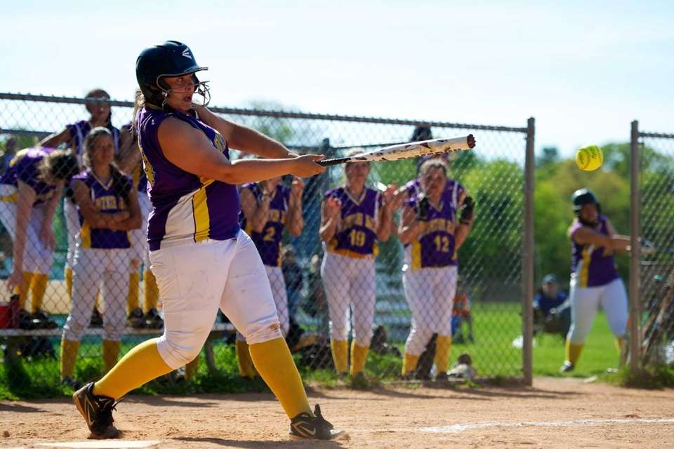 Oyster Bay catcher Danielle Agostinello swings at a