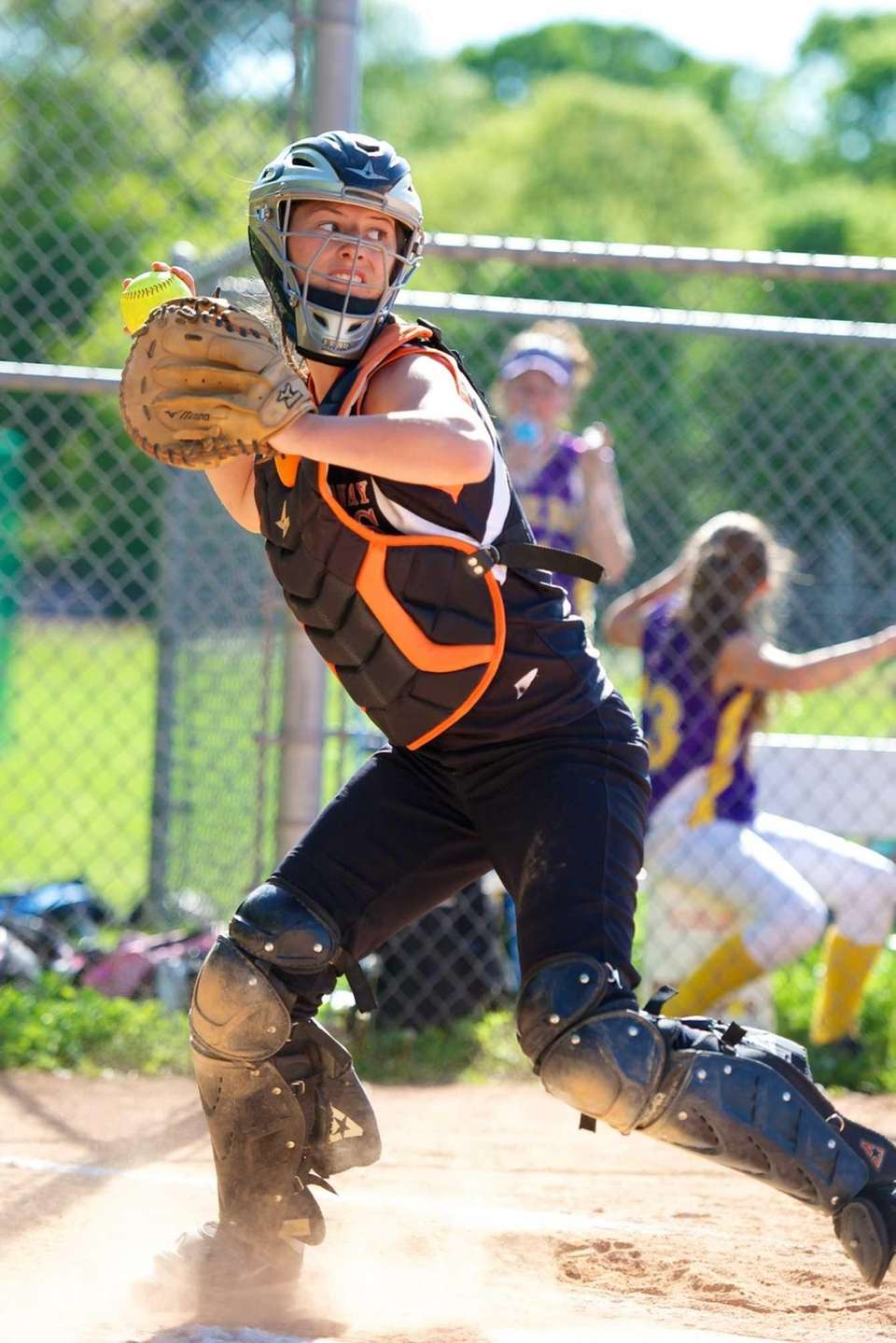 East Rockaway catcher Jess Deptulski throws the ball
