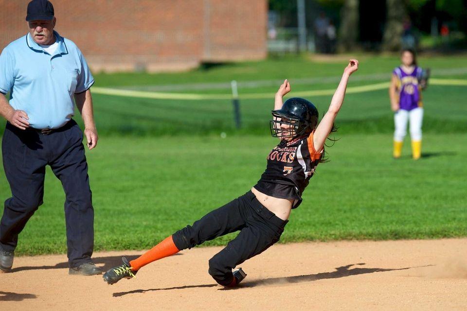 East Rockaway shortstop Gina Skelly slides in to